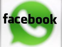 An illustration photo shows a WhatsApp messenger logo on a screen behind a Facebook logo in Zenica February 20, 2014. REUTERS/Dado Ruvic