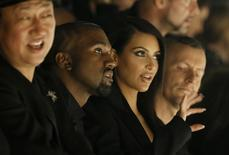 TV personality Kim Kardashian and rapper Kanye West attend the Israeli-American designer Alber Elbaz Spring/Summer 2015 women's ready-to-wear collection for fashion house Lanvin during Paris Fashion Week September 25, 2014.   REUTERS/Gonzalo Fuentes