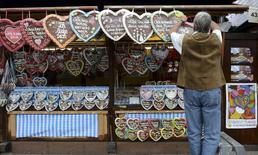 A vendor adjusts his display of gingerbread prior to the opening day of the 181st Oktoberfest in Munich, in this file picture taken September 20, 2014. REUTERS/Lukas Barth/Files