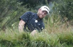 Adam Bland of Australia plays from a bunker at the eighth hole during the third round of the Australian Masters at the Victoria Golf Club near Melbourne November 13, 2010. REUTERS/Daniel Munoz