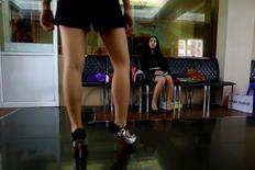 A woman trains as a model at Star model agency in Yangon August 15, 2014. REUTERS/Soe Zeya Tun