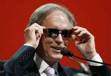 Bill Gross, co-founder and co-chief investment officer of Pacific Investment Management Company (PIMCO), adjusts his sunglasses as he arrives to speak at the Morningstar Investment Conference in Chicago, Illinois, in this file photo taken June 19, 2014.  REUTERS/Jim Young/Files