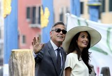 U.S. actor George Clooney and his wife Amal Alamuddin arrive at Venice city hall for a civil ceremony to formalize their wedding in Venice September 29, 2014. REUTERS/Alessandro Bianchi