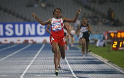 Bahrain's Maryam Yusuf Isa Jamal reacts as she crosses the finish line to win the women's 1500m final at the Incheon Asiad Main Stadium during the 17th Asian Games September 29, 2014. REUTERS/Jason Reed