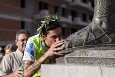 Italy's Marco Bonfiglio kisses the foot of a statue of ancient king Leonidas after completing the Spartathlon race, in Sparta, September 27, 2014. REUTERS/Alkis Konstantinidis