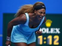 Serena Williams of the U.S. reacts after winning a point during her women's singles match against Silvia Soler-Espinosa of Spain at the China Open tennis tournament in Beijing September 29, 2014. REUTERS/Petar Kujundzic