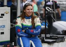 KV Racing Technology driver Simona de Silvestro of Switzerland sits on the pit lane wall smiling during a practice session prior to qualifications at the Indianapolis Motor Speedway in Indianapolis, Indiana May 18, 2013. REUTERS/Brent Smith