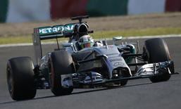 Mercedes Formula One driver Lewis Hamilton of Britain negotiates a turn during the second practice session of the Japanese F1 Grand Prix at the Suzuka Circuit October 3, 2014.  REUTERS/Toru Hanai