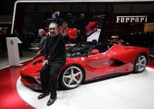 Fiat CEO Sergio Marchionne  (2L) waves after the presentation of the new LaFerrari hybrid car on the Ferrari stand during the first media day of the 83rd Geneva Car Show at the Palexpo Arena in Geneva March 5, 2013.  REUTERS/Denis Balibouse