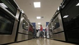 A woman walks by stoves in the appliance section at a Sears store in Schaumburg, Illinois near Chicago, September 23, 2013. REUTERS/Jim Young