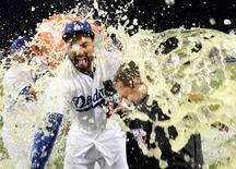 October 4, 2014; Los Angeles, CA, USA; Los Angeles Dodgers left fielder Matt Kemp (27) has gatorade poured celebrating the 3-2 victory against the St. Louis Cardinals following game two of the 2014 NLDS playoff baseball game at Dodger Stadium. Mandatory Credit: Jayne Kamin-Oncea-USA TODAY Sports