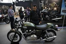 A visitor looks at a Triumph motorcycle on display at the Indonesian International Motor Show in Jakarta September 19, 2014. REUTERS/Darren Whiteside
