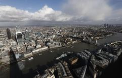 Buildings in the City of London (L) and Canary Wharf (R) are seen from The View gallery at the Shard, western Europe's tallest building, in London January 28, 2014.  REUTERS/Suzanne Plunkett