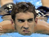 O norte-americano Michael Phelps vence a final dos 100m estilo borboleta no campeonato mundial de natação em Xangai, na China, em 2011. 30/07/2011 REUTERS/Christinne Muschi