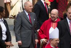 U.S. Supreme Court Justice Anthony Kennedy  (L, gray suit and red tie) speaks with a member of the clergy as they exit following the Red Mass, a service to mark the beginning of this year's Supreme Court term, at the Cathedral of St. Matthew the Apostle in Washington October 5, 2014. REUTERS/Jonathan Ernst