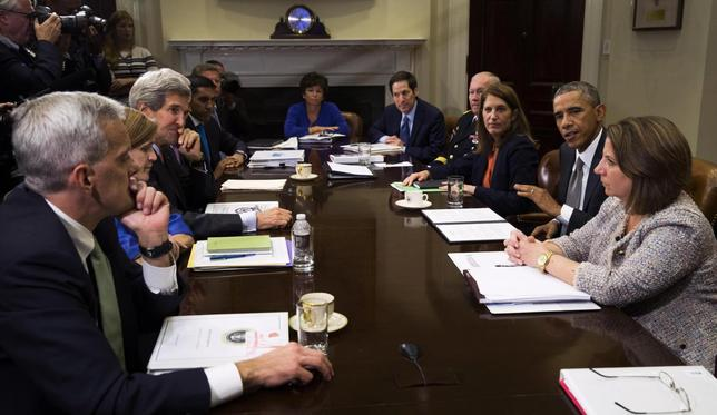 U.S. President Barack Obama meets with members of his national security team and senior staff to receive an update on the Ebola outbreak in West Africa, at the White House in Washington October 6, 2014. REUTERS/Kevin Lamarque