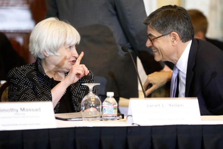 U.S. Federal Reserve Chair Janet Yellen (L) and Treasury Secretary Jack Lew (R) confer after a meeting of the Financial Stability Oversight Council at the Treasury Department in Washington October 6, 2014. REUTERS/Jonathan Ernst