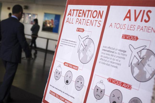 A sign asks patients to inform staff if they have fever, cough, trouble breathing, rash, vomiting or diarrhea symptoms and have recently traveled internationally or have had contact with someone who recently traveled internationally at Bellevue Hospital in Manhattan, New York October 8, 2014.  REUTERS/Adrees Latif