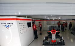 The car of Marussia Formula One driver Jules Bianchi of France is pictured in the garage during the first free practice session of the  Russian F1 Grand Prix in the Sochi Autodrom circuit October 10,2014. REUTERS/Laszlo Balogh