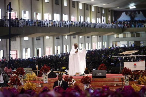 Bishop David Oyedepo (C), founder of the Living Faith Church, also known as the Winners' Chapel, conducts a service for worshippers in the auditorium of the church in Ota district, Ogun state, some 60 km (37 miles) outside Nigeria's commercial capital Lagos September 28, 2014. REUTERS-Akintunde Akinleye