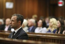 South African Olympic and Paralympic track star Oscar Pistorius listens to the verdict in his trial at the high court in Pretoria September 12, 2014. REUTERS/Siphiwe Sibeko