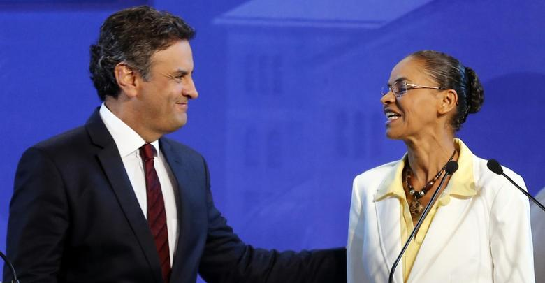 Marina Silva (R) of the Brazilian Socialist Party (PSB) greets Aecio Neves of the Brazilian Social Democracy Party (PSDB) before a TV debate in the city of Aparecida do Norte September 16, 2014. REUTERS/Paulo Whitaker