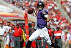 Oct 12, 2014; Tampa, FL, USA; Baltimore Ravens quarterback Joe Flacco (5) throws the ball against the Tampa Bay Buccaneers during the first half at Raymond James Stadium. Mandatory Credit: Kim Klement-USA TODAY Sports
