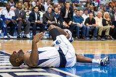 Oct 10, 2014; Dallas, TX, USA; Dallas Mavericks guard Raymond Felton (2) falls to the court with an apparent leg injury during the first half against the Oklahoma City Thunder at the American Airlines Center. Mandatory Credit: Jerome Miron-USA TODAY Sports