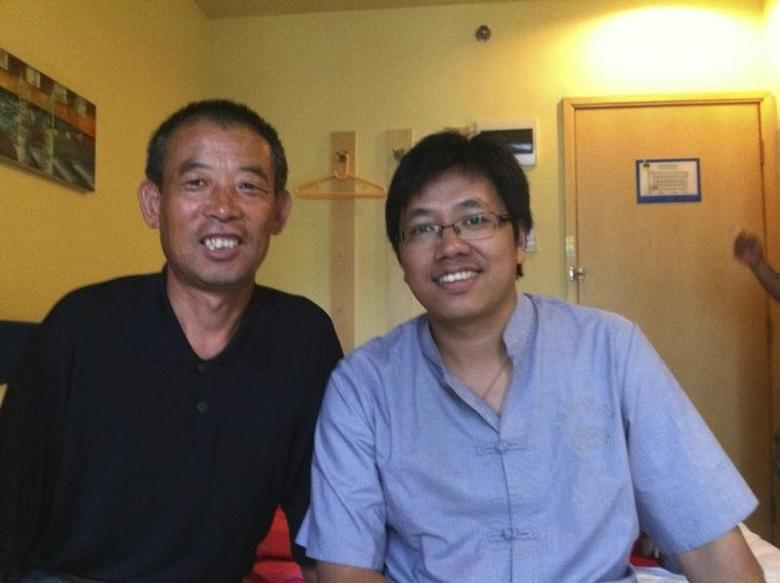 A handout photo shows Chen Guangfu (L), elder brother of blind activist Chen Guangcheng and father of Chen Kegui, posing with Guo Yushan (R), a Beijing-based researcher and rights activist, during a meeting in Nanjing, Jiangsu province September 11, 2011. REUTERS/Handout