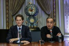 Sergio Marchionne (R), chief executive officer of Fiat Chrysler Automobiles and John Elkann, chairman of Fiat Chrysler Automobiles, speak with the media before ringing the closing bell to celebrate the company's listing at the New York Stock Exchange, October 13, 2014.  REUTERS/Eduardo Munoz