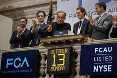 Sergio Marchionne (C), chief executive officer of Fiat Chrysler Automobiles, rings the closing bell to celebrate the company's listing at the New York Stock Exchange, October 13, 2014. REUTERS/Eduardo Munoz