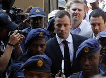 Olympic and Paralympic track star Oscar Pistorius arrives at the North Gauteng High Court in Pretoria, October 13, 2014.    REUTERS/Mike Hutchings