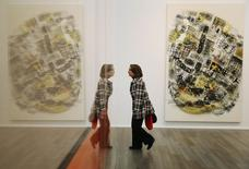 A visitor passes Richard Prince's untitled artwork at the Frieze Masters in London October 15, 2014.  REUTERS/Luke MacGregor