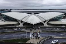 People make their way at the international arrival terminal at JFK airport in New York October 11, 2014. REUTERS/Eduardo Munoz