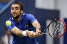 Marin Cilic of Croatia returns a shot during his men's singles tennis match against Ivo Karlovic of Croatia at the Shanghai Masters tennis tournament in Shanghai October 6, 2014. REUTERS/Aly Song