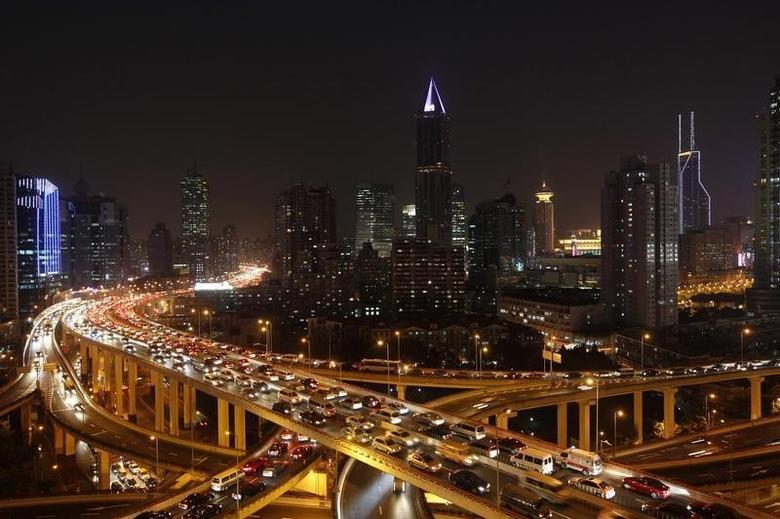 Vehicles drive on flyovers during the evening rush hour in central Shanghai December 29, 2010. REUTERS/Aly Song