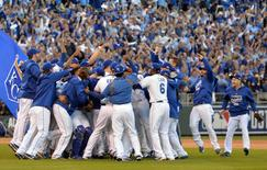 Kansas City Royals players celebrate on the field after game four of the 2014 ALCS playoff baseball game against the Baltimore Orioles at Kauffman Stadium.   REUTERS/Peter G. Aiken via USA TODAY Sports