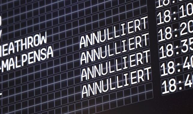 An electronic information board shows cancelled flights at Cologne-Bonn airport October 16, 2014. REUTERS/Ina Fassbender