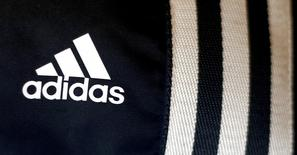 File photo of the logo of Adidas, the world's second largest sports apparel firm, in a store in Munich March 4, 2014.   REUTERS/Michael Dalder/Files