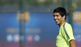 Jogador uruguaio  Luis Suarez , do Barça, durante treino em Joan Gamper, perto de Barcelona. 20/10/2014 REUTERS/Albert Gea