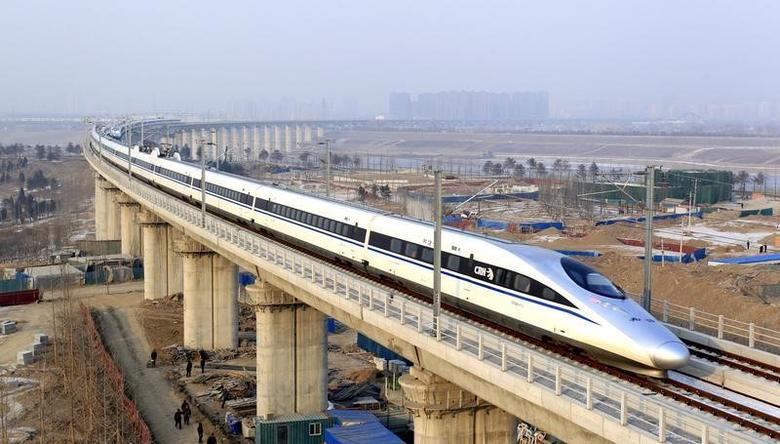 A high-speed train travelling to Guangzhou is seen running on Yongdinghe Bridge in Beijing, December 26, 2012. REUTERS/China Daily
