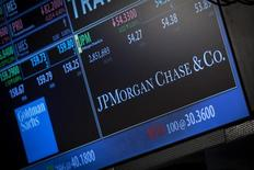 A screen displays JP Morgan Chase & Co. at the post that the stock is traded at on the floor of the New York Stock Exchange, October 21, 2013. REUTERS/Brendan McDermid