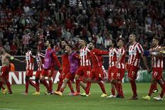 Jogadores do Olympiakos comemoram vitória sobre Juventus.  REUTERS/Alkis Konstantinidis