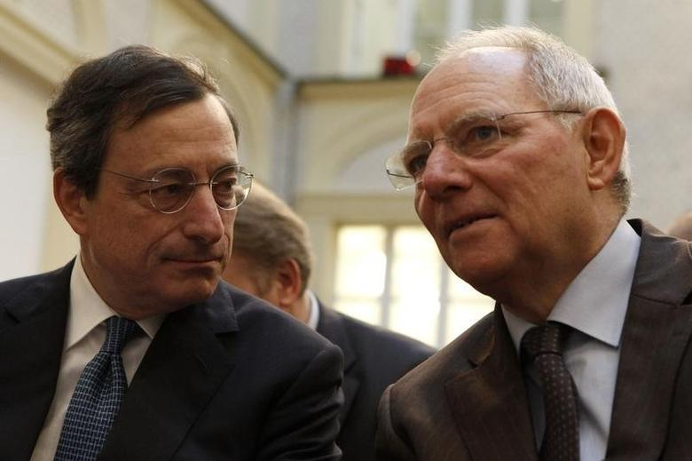 German Finance Minister Wolfgang Schaeuble (R) talks to European Central Bank (ECB) President Mario Draghi (C) during a discussion in Berlin, December 15, 2011.   REUTERS/Fabrizio Bensch