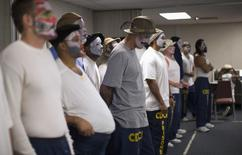 "Inmates participate in the workshop ""Commedia Dell'Arte"", part of the The Actors' Gang Prison Project program at the California Rehabilitation Center in Norco, California in this September 30, 2014 file photo. REUTERS/Mario Anzuoni/Files"