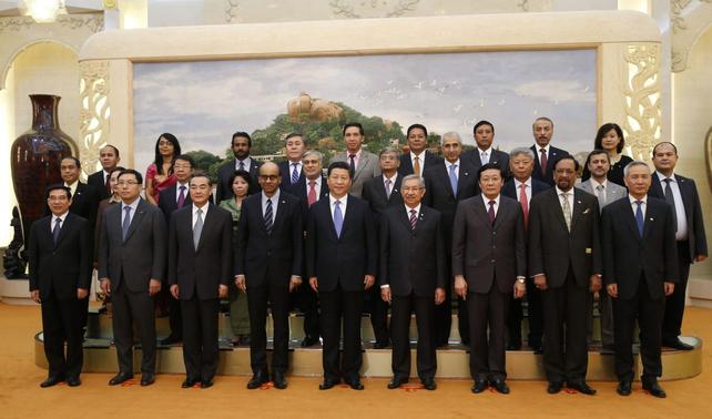China's President Xi Jinping (C) poses for photos with the guests at the Asian Infrastructure Investment Bank launch ceremony at the Great Hall of the People in Beijing October 24, 2014.  REUTERS-Takaki Yajima-Pool