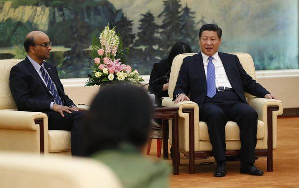 China's President Xi Jinping (R) meets with the guests at the Asian Infrastructure Investment Bank launch ceremony at the Great Hall of the People in Beijing October 24, 2014.  REUTERS-Takaki Yajima-Pool