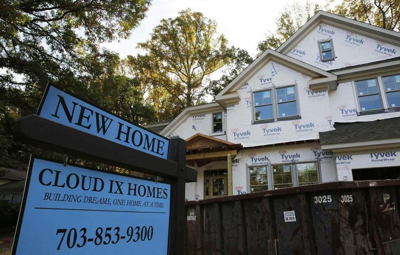 A real estate sign advertising a new home is pictured in Vienna, Virginia, outside of Washington, October 20, 2014.       REUTERS/Larry Downing