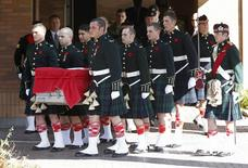 Pallbearers from Argyll and Sutherland Highlanders of Canada regiment carry the casket of Cpl. Nathan Cirillo from a funeral home in Ottawa October 24, 2014.  REUTERS/Chris Wattie