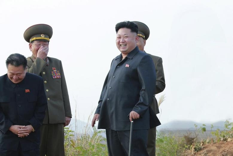 North Korean leader Kim Jong Un guides a takeoff and landing drill on a highway-airfield conducted by fighter pilots of Korean People's Army (KPA) Air and Anti-Air Force Units 1017 and 458 in this undated photo released by North Korea's Korean Central News Agency (KCNA) in Pyongyang October 19, 2014. REUTERS/KCNAATTENTION EDITORS - THIS PICTURE WAS PROVIDED BY A THIRD PARTY. REUTERS IS UNABLE TO INDEPENDENTLY VERIFY THE AUTHENTICITY, CONTENT, LOCATION OR DATE OF THIS IMAGE. FOR EDITORIAL USE ONLY. NOT FOR SALE FOR MARKETING OR ADVERTISING CAMPAIGNS. THIS PICTURE IS DISTRIBUTED EXACTLY AS RECEIVED BY REUTERS, AS A SERVICE TO CLIENTS. NO THIRD PARTY SALES. NOT FOR USE BY REUTERS THIRD PARTY DISTRIBUTORS. SOUTH KOREA OUT. NO COMMERCIAL OR EDITORIAL SALES IN SOUTH KOREA - RTR4APYX